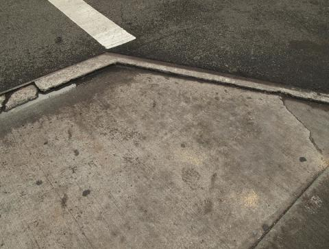 wet-pavement-on-manhattan-street-corner-robert-englebright